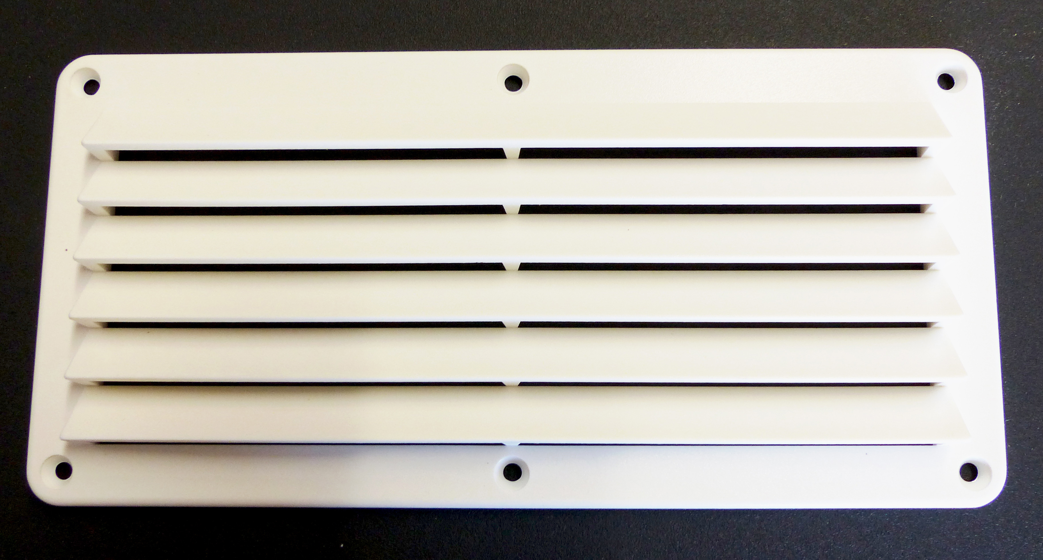 white plastic vent front view
